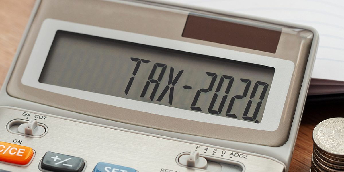 Tax Word And 2020 Number On Calculator. Business And Tax Concept